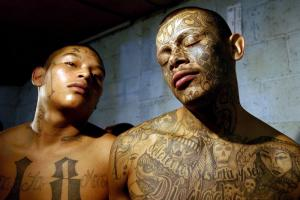 "Two members of the gang ""Maras 18"" pose after their arrest in Guatemala."