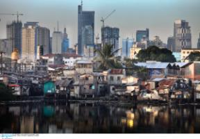 Inequality has been growing almost everywhere: slum huts and highrise buildings in Manila in 2009.
