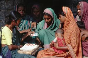 Community health worker promoting condom use in a village in 1995.