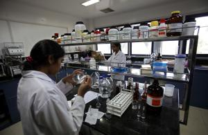 India's private sector has grown fast: pharma lab in Hyderabad.