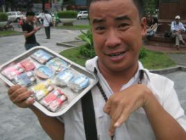 Agent-orange victim selling souvenirs in Ho-Chi-Minh-City: people with disabilities tend to be marginalised.