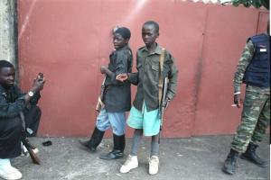 Many armed fighters do not wear standardised uniforms, but they all have weapons: child soldiers in Goma.