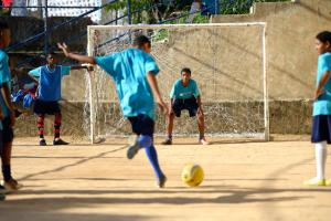 """Sports are very competitive"": football game in a Brazilian favela."