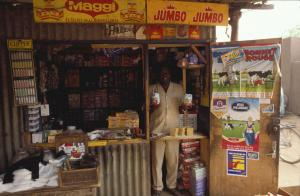 A retailer in Burkina Faso sells Dutch products, including milk powder, in his small store.