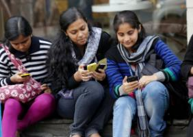 Students with smartphones in Kolkata.
