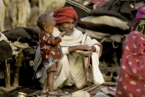 India currently has comparatively few very young and very old persons: an infant and an old man from a rural community in Rajasthan