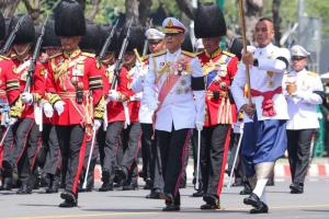 Thailand's King Maha Vajiralongkorn (center) and honour guard march at a ceremony for late King Bhumibol Adulyadej in October 2017.