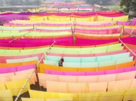 Dyeing processes typically involve over 1,600 different chemicals: drying textiles at a factory in Bangladesh.