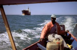 Overfishing is a global issue: Japanese trawler competing with African fishing boat near Senegal's coast.