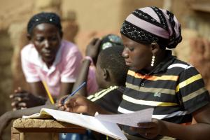 Education matters: a high-school student doing homework in rural Burkina Faso.