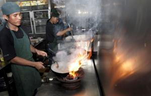 Mith Samlanh runs a restaurant in Phnom Penh, where former street children work as cooks or waiters.