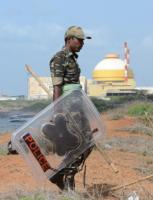 A policeman patrols the seashore near the Koodankulam nuclear plant in the south Indian State of Tamil Nadu.