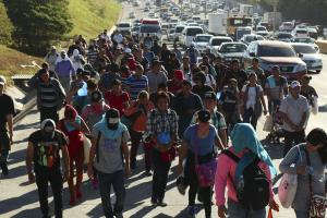 Migrant caravan  from Honduras on a highway in El Salvador in January 2019. People try to get to the USA on foot.