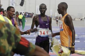 Kenyan athlete Abraham Kipton (centre) won the Lagos City Marathon in February.