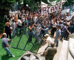Argentinians storm the barricades in front of the Ministry of Justice in Buenos Aires, December 2001.