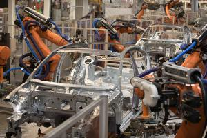Robots assemble VW components in Germany.