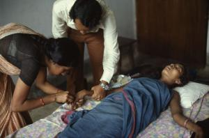 A tetanus patient is treated at a GK facility in the 1990s.
