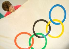 Dilma Rousseff with Olympic flag in 2012.