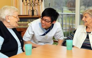 A young man from Vietnam is trained to become a staff member in a retirement home near Munich in 2014.