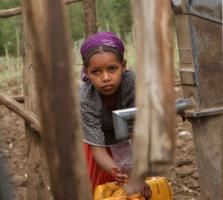 Girl at a well in Ethiopia.