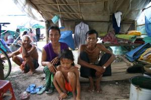 Illness has made the breadwinner (right) in this Cambodian family unfit for work.
