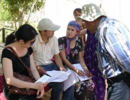 Interviewees discussing on questionnaires in Tajikistan.
