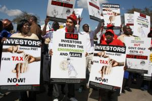ActionAid posters used at tax justice march in Lusaka, Zambia.