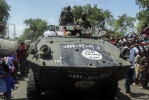 Soldiers parading an armored vehicle seized from Boko Haram in Maiduguri.