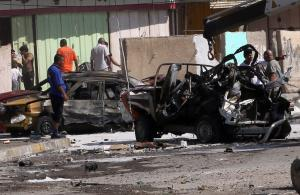 Violence may flare up any time: wreck of car bomb in Baghdad in late September 2013.