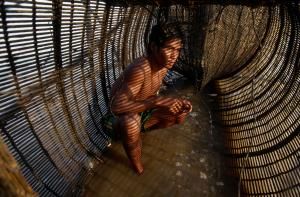 Repairing a fish trap: most of the people living on the Tonle Sap Lake are fisherfolk.