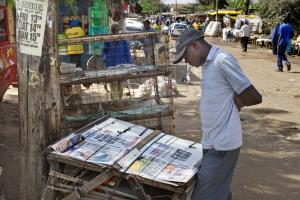 Literacy rates have risen, and more countries now enjoy the freedom of the speech than in the 1980s: newspaper stand in Nairobi.