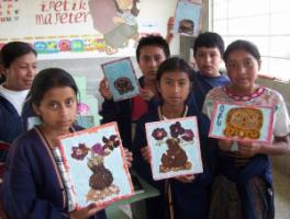 To ensure inclusive primary education, bilingual and intercultural instruction is needed: indigenous pupils show handcrafted pictures of Maya symbols.