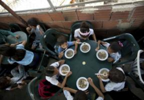 Children receiving a free meal at a soup kitchen in Caracas funded by the opposition.