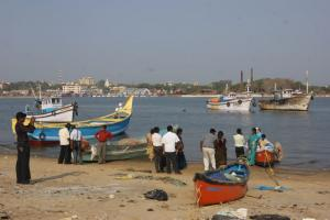 Fishing boats and tourists in Mangaluru.