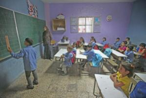 The number of refugees puts a strain on Lebanon's infrastructure. This school offers afternoon classes for Syrian children.