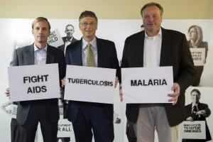 Shared concern: Dirk Niebel and Bill Gates with Mark Dybul, the executive director of the Global Fund to Fight AIDS, Tuberculosis and Malaria at a photo opportunity during the World Economic Forum in Davos in January 2013.