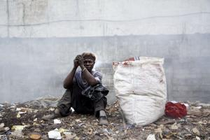 Waste collector in Sierra Leone: Donor funding is still needed to reduce poverty.