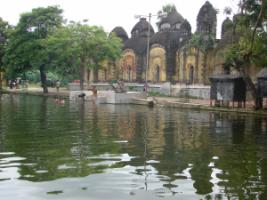 Shiva temples on the banks of Chatterjee Para Pond.
