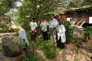 Development worker talking to project partners in Cambodia 2005.