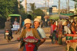 Cambodia's government is concerned that TPP will divide southeast Asian countries. Textile workers on their way to work in Phnom Penh.