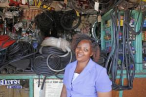A micro-loan enabled this Kenyan woman to open a hardware store.