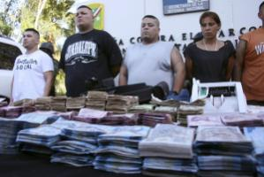 Not all groups are hit alike: Suspected members of a mexican drug cartel after being taken in custody in May