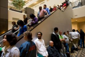 The global financial crisis has cast doubt on many paradigms: job applicants lining up in Denver, Colorado, in May