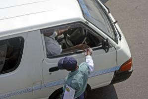 Traffic constable collecting a bribe in Dhaka, Bangladesh