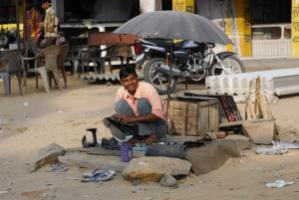 """The subsidiarity principle is about helping people in need who cannot help themselves. When people are in a position to advance through their own efforts, intervention is not warranted"". Shoe shining in Rajasthan, India"