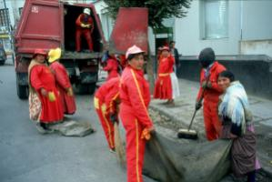 Bolivian women cleaning  the street in La Paz