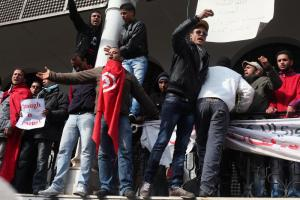 Young men demanding that all former RCD members  quit their country's government in Tunis in late January