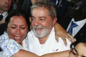 Lula da Silva is embraced by a supporter in Dakar