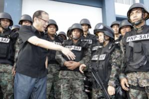 President Aquino – pictured at a police-training event – promises change