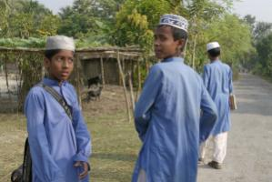 """""""An unknown number of Islamic NGOs working in Bangladesh are believed to receive funds from the Saudis and other Islamic sources, and their madrasas serve an important social role."""" Rural boys on their way to a madrasa"""